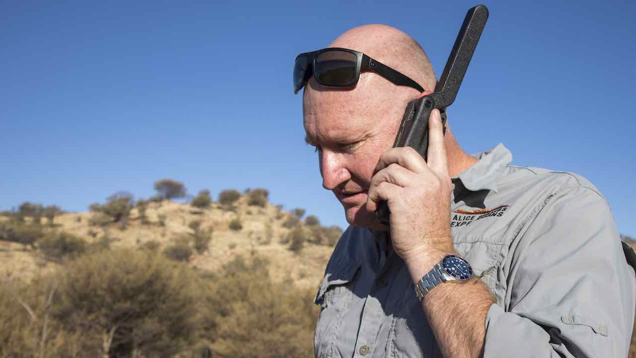 John Stafford carries safety equipment including a Satellite phone